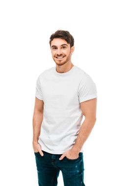 Handsome happy young man standing with hands in pockets and smiling at camera isolated on white stock vector