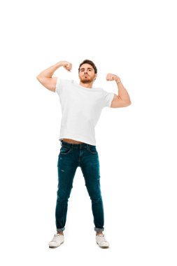 Confident young man showing biceps and looking at camera isolated on white stock vector