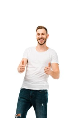 handsome happy young man showing thumbs up and smiling at camera isolated on white