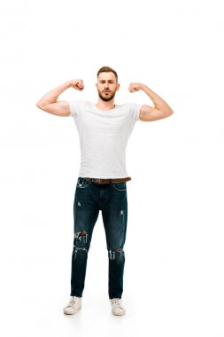 Full length view of handsome bearded young man showing biceps and looking at camera isolated on white stock vector