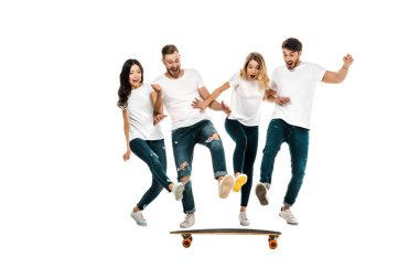 Happy young friends having fun with skateboard isolated on white stock vector