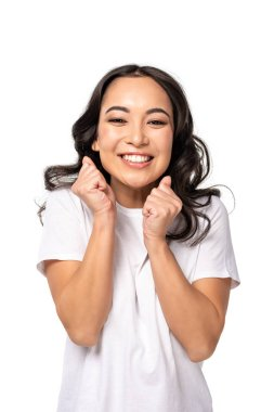 happy asian smiling woman holding fists close to face isolated on white