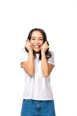Smiling asian young woman holding hand fists near face isolated on white stock vector