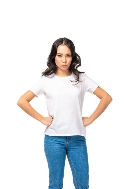 Angry asian woman in white t-shirt and blue jeans holding hands on hips isolated on white stock vector