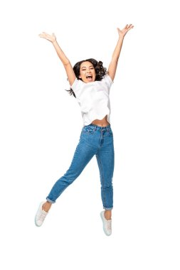 Happy young asian woman jumping up with raised hands isolated on white stock vector