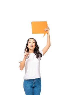 Surprised asian woman holding speech bubble and showing idea sign isolated on white