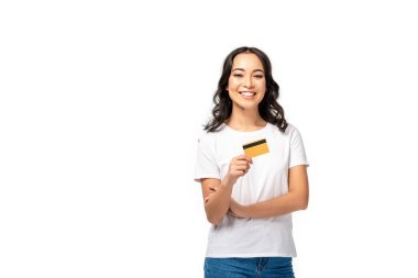 Smiling asian young woman in white t-shirt holding credit card isolated on white stock vector