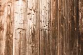 Fotografie braun verwitterte gealterte Holzplanken mit Kopierraum