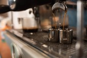 Selective focus of coffee machine and two stainless cups