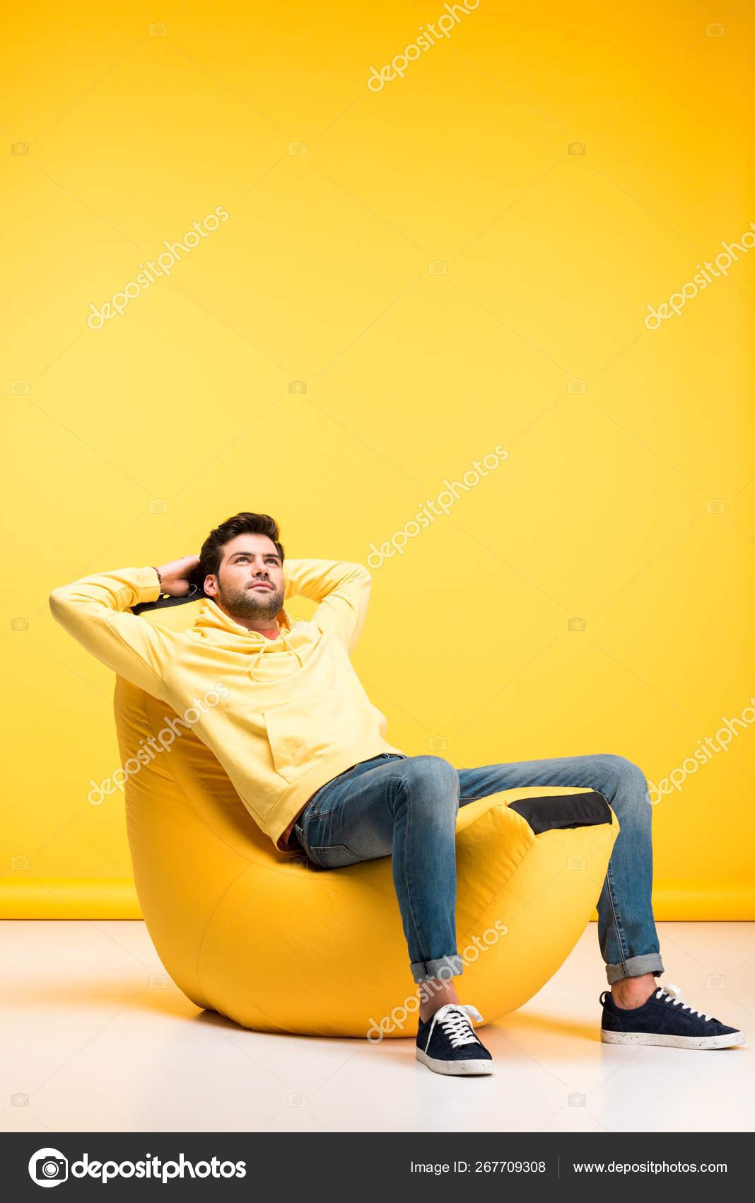 Terrific Man Hands Back Relaxing Bean Bag Chair Yellow Stock Photo Customarchery Wood Chair Design Ideas Customarcherynet