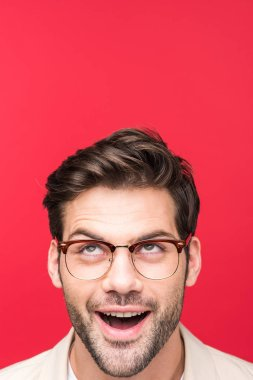 Surprised handsome man in glasses looking up Isolated On pink stock vector