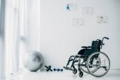 recovery room in hospital with wheelchair and sport equipment