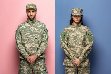 Man and woman in military uniform looking at camera on blue and pink stock vector
