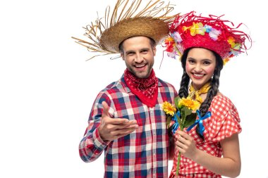 cheerful man and young woman in festive clothes with sunflowers isolated on white
