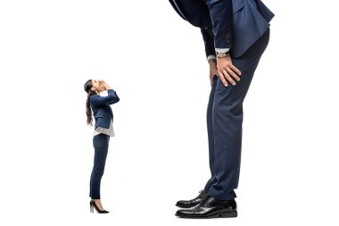 Small businesswoman shouting at big businessman Isolated On White stock vector