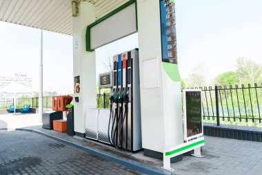 gas pumps with benzine at modern gas station