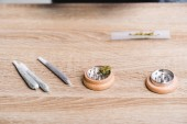 joints with medical marijuana and herb grinder on table