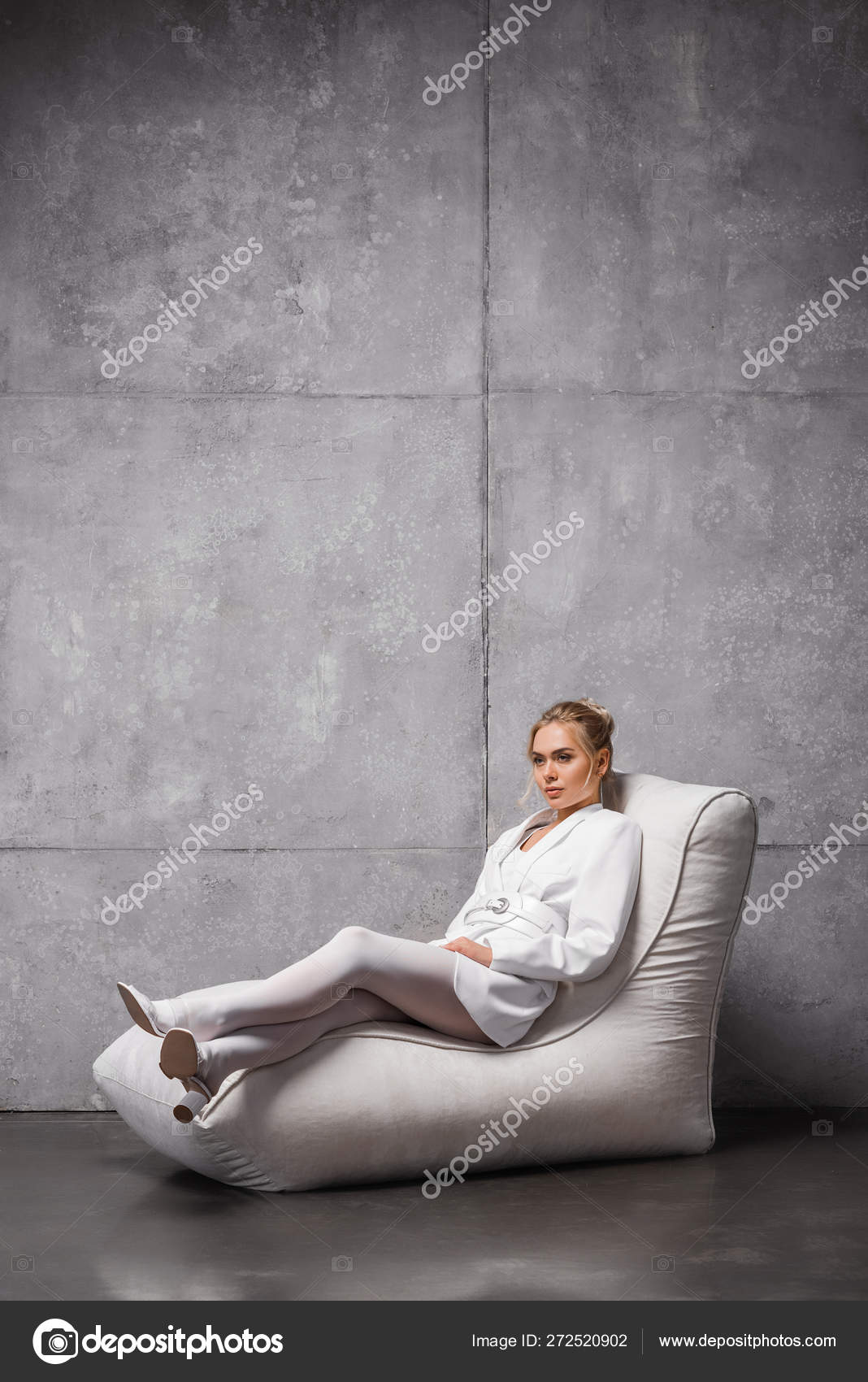 Awesome Pretty Young Woman Sitting Soft Bean Bag Chair Grey Stock Andrewgaddart Wooden Chair Designs For Living Room Andrewgaddartcom