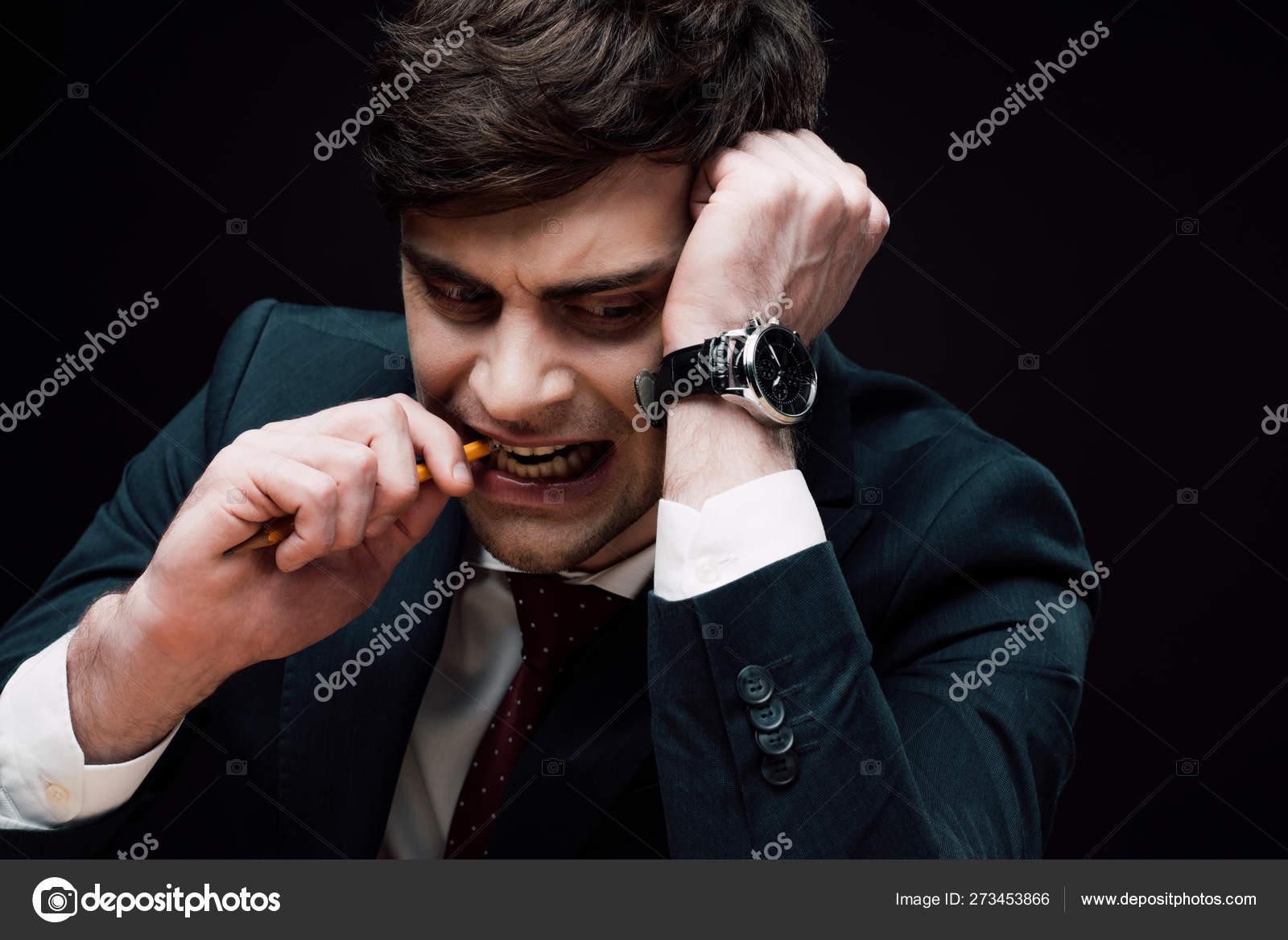 https depositphotos com 273453866 stock photo upset worried businessman biting pencil html