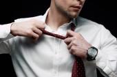 részleges kilátás ideges üzletember levette nyakkendő izolált fekete
