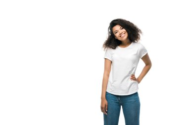 happy african american girl in white t-shirt standing with hand on hip isolated on white