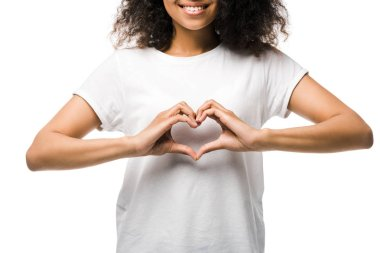 Cropped view of happy african american girl showing heart with hands isolated on white stock vector