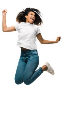 Cheerful african american woman gesturing while celebrating and jumping isolated on white stock vector