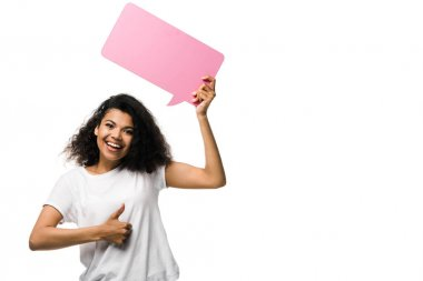 Cheerful african american girl holding pink speech bubble and showing thumb up isolated on white stock vector