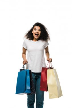 Excited african american girl holding shopping bags isolated on white stock vector