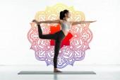 Photo asian woman practicing yoga on yoga mat near mandala ornament on white