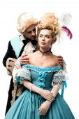 handsome man in wig touching shoulders of attractive victorian woman in blue dress isolated on white