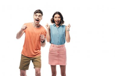 excited man and woman smiling at camera and showing yes gestures isolated on white