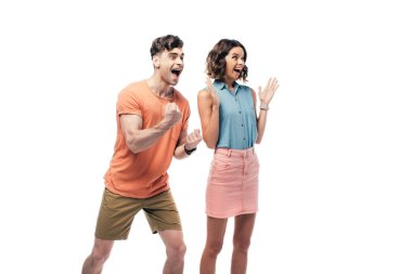 excited man and woman looking away and showing yes gestures isolated on white