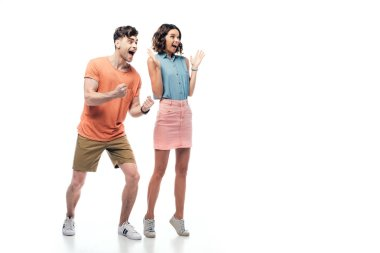 excited man and woman showing yes gestures and looking away on white background