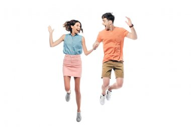 Excited man and woman jumping while looking at each other isolated on white stock vector