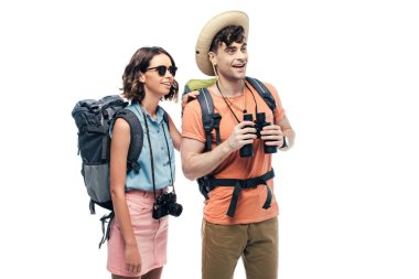 Two young tourists with binoculars and digital camera looking away and smiling isolated on white stock vector