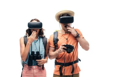 two young shocked tourists using virtual reality headsets isolated on white