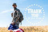 soldier in uniform holding american flag while standing in field with thank you for your service illustration