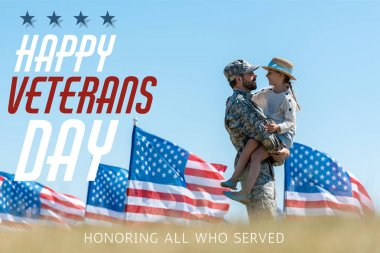 Selective focus of man in military uniform holding in arms cheerful kid near american flags with happy veterans day, honoring all who served illustration stock vector