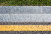 Fotografie close up of border near road and green grass