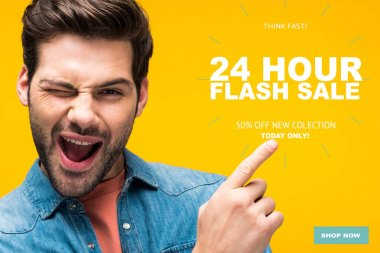 handsome man pointing with finger at 24 hour flash sale illustration and winking isolated on yellow, online shopping concept