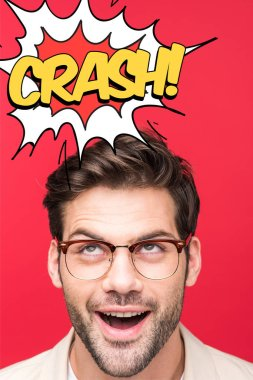Excited handsome man in glasses looking up isolated on red with crash lettering stock vector