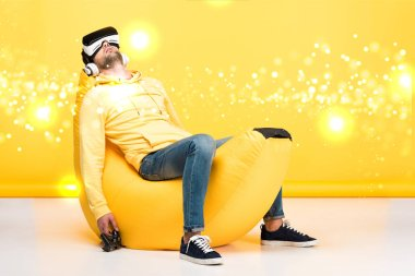 KYIV, UKRAINE - APRIL 12: man sleeping on banana bean bag chair with joystick in virtual reality headset on yellow with cyberspace illustration stock vector