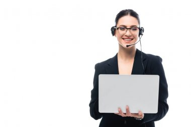Smiling call center operator in headset using laptop while looking at camera isolated on white stock vector
