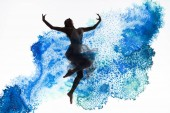graceful ballerina dancing in blue paint splashes and spills isolated on white
