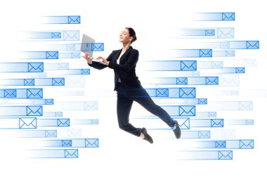Young businesswoman using laptop while levitating near e-mail icons isolated on white stock vector