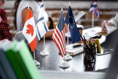 selective focus of flags of america, canada, european union and israel