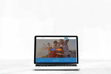 KYIV, UKRAINE - JULY 23, 2019: modern laptop with couchsurfing website on screen on white stock vector
