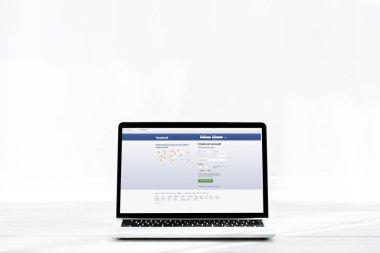 KYIV, UKRAINE - JULY 23, 2019: modern laptop with facebook website on screen on white stock vector