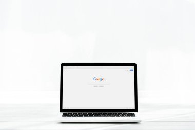 KYIV, UKRAINE - JULY 23, 2019: modern laptop with google website on screen on white stock vector